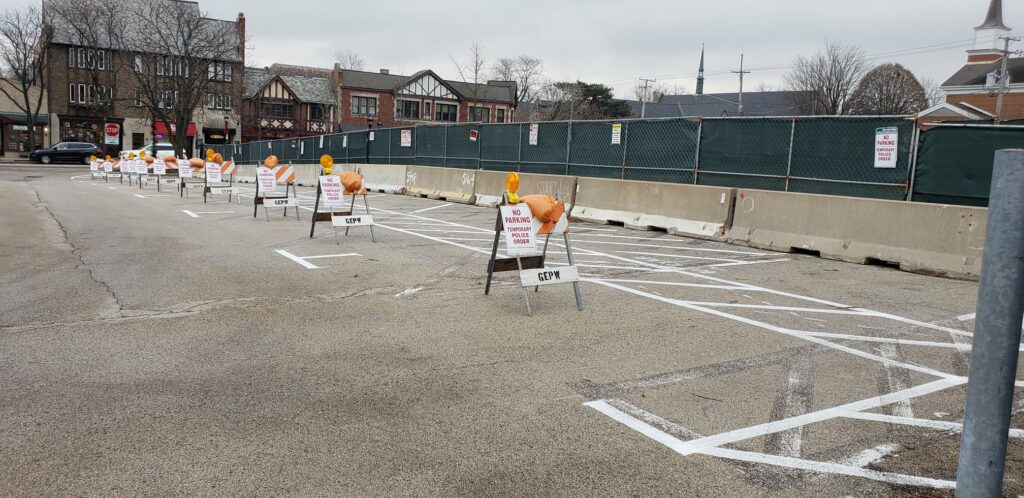 B Used to contain 14 spaces painted straight-in; now a larger buffer from the demolition site is required. 7 spaces are painted as parallel, but they are still not available.
